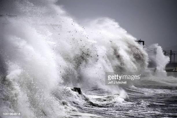 Waves crash against the sea wall as Storm Callum hits the seafront on October 12 2018 in Saltcoats Scotland Storm Callum is currently tracking across...