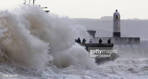 Waves crash against the sea wall at Porthcawl south Wales on August 21 2020 as Storm Ellen brings high winds across the country Weather warnings were...