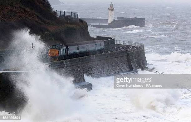 Waves crash against the sea wall near Whitehaven in Cumbria, as high winds have brought travel chaos and power cuts as they buffet some parts of the...