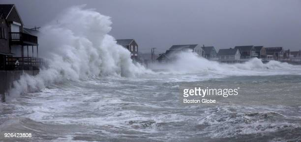 Waves crash against the seawall along Turner Road in Scituate MA during a nor'easter storm on March 2 2018