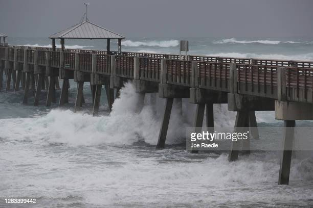 Waves crash along the Juno Beach Pier as Tropical Storm Isaias passes through the area on August 02, 2020 in Juno Beach, Florida. The storm is...