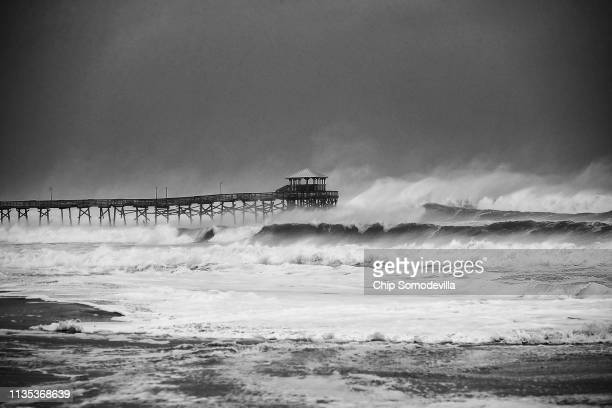Waves crash around the Oceana Pier as the outer edges of Hurricane Florence being to affect the coast September 13 2018 in Atlantic Beach United...