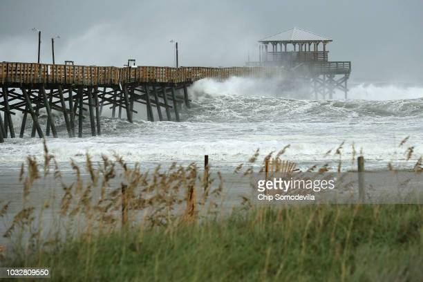 Waves crash around the Oceanana Pier as the outer edges of Hurricane Florence being to affect the coast September 13 2018 in Atlantic Beach United...