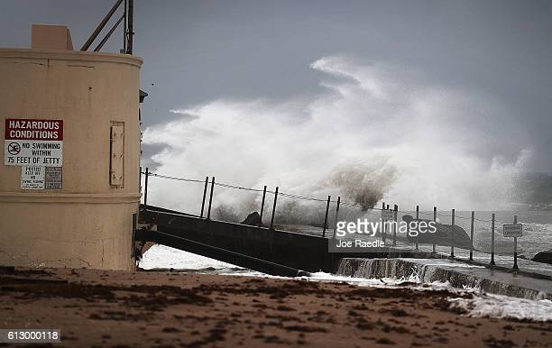 Waves crash ashore as Hurricane Matthew approaches the area on October 6 2016 in Singer Island Florida The hurricane is expected to make landfall...