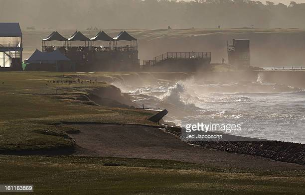 Waves crash in Stillwater Cove on the 18th hole during the third round of the ATT Pebble Beach National ProAm at Pebble Beach Golf Links on February...