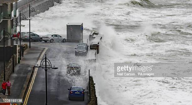 Waves crash into the seafront at Tramore in County Waterford, on the southeast coast of Ireland.