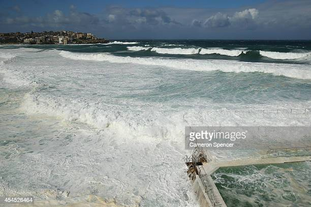 Waves crash over Icebergs Pool at Bondi Beach on September 3 2014 in Sydney Australia Sydney's beaches and the harbour have been hit by large swells...