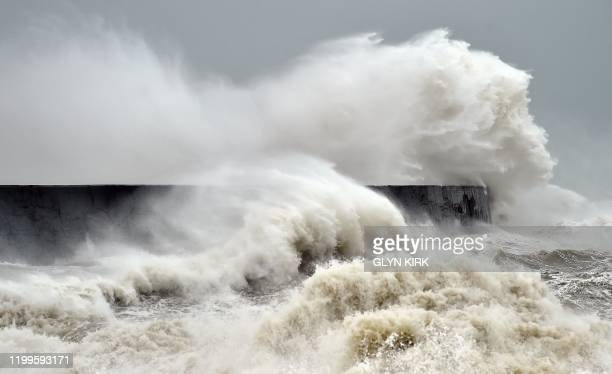 Waves crash over Newhaven Lighthouse on the south coast of England on February 9 as Storm Ciara swept over the country. - Britain and Ireland...