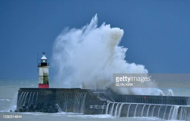 Waves crash over Newhaven Lighthouse on the south coast of England on December 27 as Storm Bella brings rain and high winds to the UK. - Most of the...