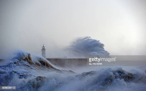 Waves crash over Newhaven Lighthouse on the south coast of England on February 8 as the latest storm hits the country Heavy winds buffeted Europe's...