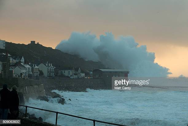 Waves crash over the cliffs at Sennen near Land's End on February 8 2016 in Cornwall England Parts of the UK are currently being battered by Storm...