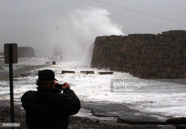 Waves crash over the flooded breakwater wall during a nor'easter storm at Lane's Cove in Gloucester MA on March 2 2018