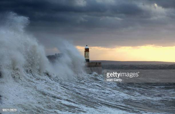 Waves crash over the harbour at Porthcawl on November 19 2009 in Porthcawl Wales The UK is currently braced for more severe weather today with almost...