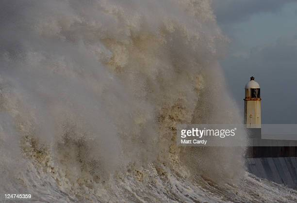 Waves crash over the harbour wall in Porthcawl on September 12 2011 in Wales Parts of the country are to be hit by severe gales as the remnants of...