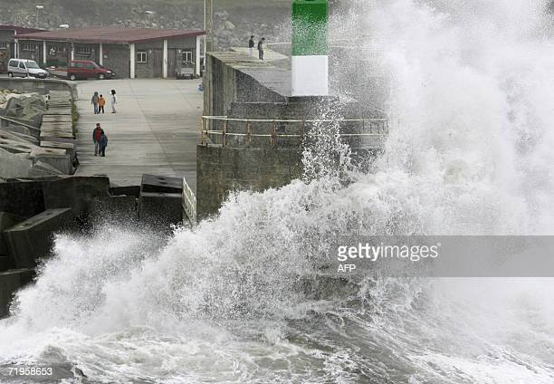 Waves crash over the sea wall at A Guarda harbour in Spain's northwestern province of Galicia 21 September 2006 Twelve Spanish regions were on alert...