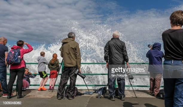 Waves crash over the sea wall during the 30th Sunderland International Air show on July 28 2018 in Sunderland England Held over three days on and...