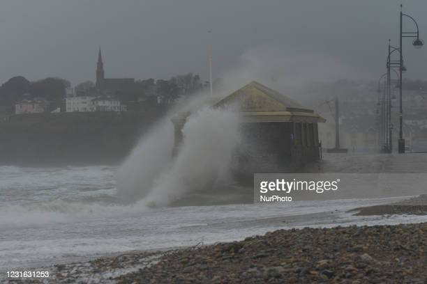Waves crash the strand at Tramore in County Waterford on the South East coast of Ireland, where the yellow 100 km/h weather warning is in effect. On...