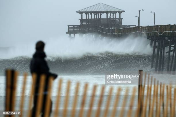 Waves crash underneath the Oceanana Pier as the outer bands of Hurricane Florence being to affect the coast September 13 2018 in Atlantic Beach...