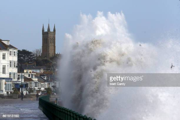 Waves crash up onto Penzance seafront on October 16 2017 in Cornwall England The hurricane comes exactly 30 years after the Great Storm of 1987 which...