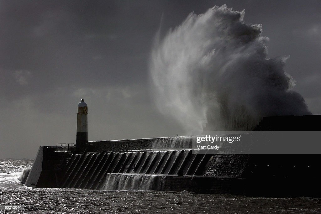 A waves crashes over the harbour wall on the seafront at Porthcawl on March 12 2008 in Wales, United Kingdom. The British Isles is being battered for the second time in three days by severe gales and heavy rain and forecasters have reported gusts of up to 80mph hitting Northern Ireland as the Atlantic weather front moves eastwards.