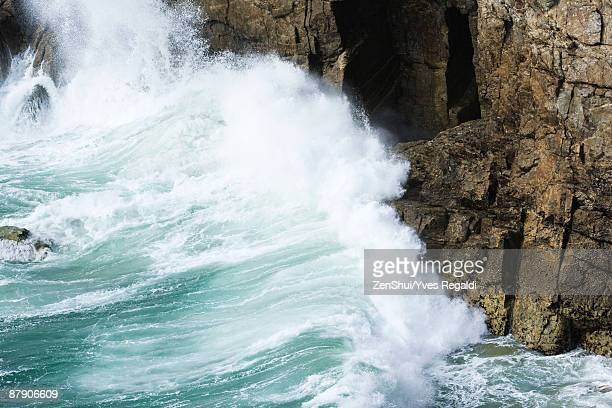 waves crashing against cliff side, close-up - erosion stock pictures, royalty-free photos & images