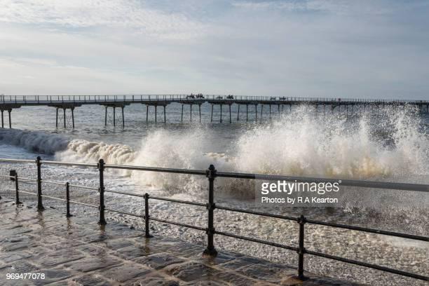 Waves crashing against promenade at Saltburn-by-the-sea, North Yorkshire, England