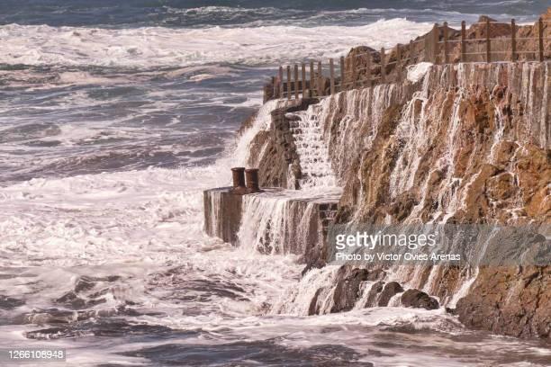 waves crashing against the rocks in benijo in the anaga rural park in tenerife - victor ovies fotografías e imágenes de stock