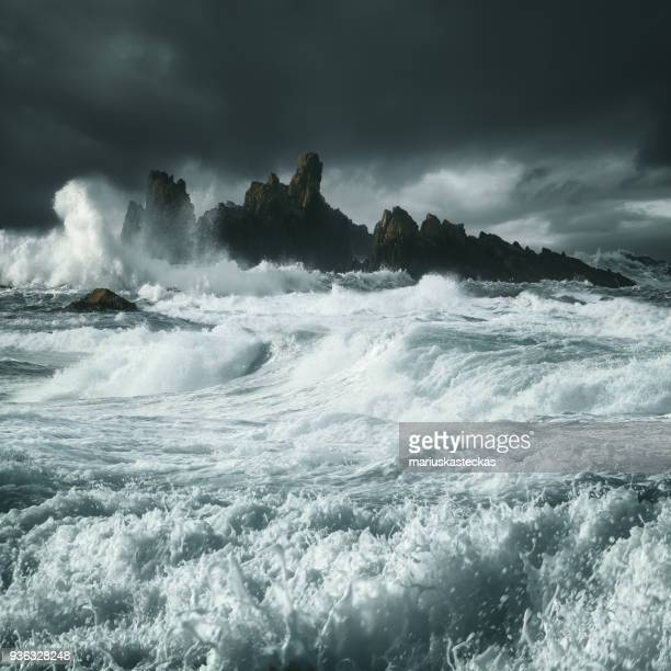 waves crashing along rocky coastline, county antrim, northern ireland, uk - county antrim stock pictures, royalty-free photos & images