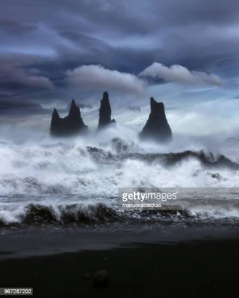 waves crashing along rocky coastline, iceland - black sand stock pictures, royalty-free photos & images
