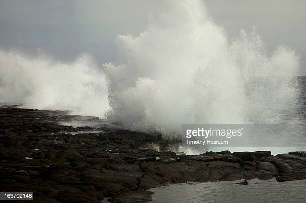 waves crashing into coastal lava; ocean beyond - timothy hearsum stock pictures, royalty-free photos & images