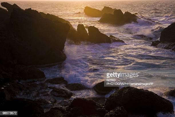 waves crashing on rocks, echizen-machi, fukui prefecture, japan - fukui prefecture stock photos and pictures