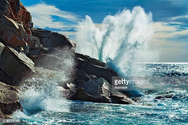 Waves crashing on rocks in Bluestone Bay Freycinet National Park Tasmania Australia