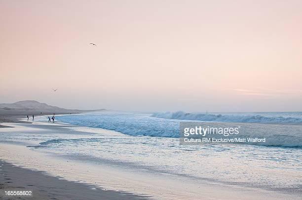 Waves crashing on white sand beach