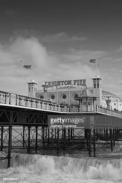 CONTENT] Waves crashing underneath Brighton Pier in England
