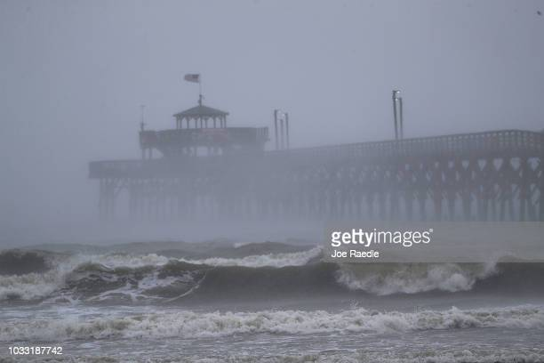 Waves created by Hurricane Florence are seen along Cherry Grove Fishing Pier on September 14 2018 in North Myrtle Beach United States Hurricane...