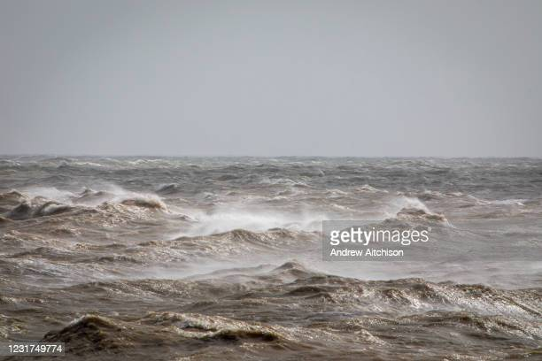 Waves cresting on the south coast of England as a major storm swept over the country on 11th of March 2021, in Folkestone, United Kingdom. Amber...