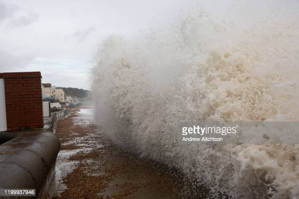 Waves cresting over the pedestrian walkway in Sandgate Kent on the south coast of England as Storm Ciara continues to sweep over the country on...