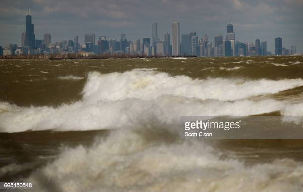 Waves from Lake Michigan crash ashore on April 6 2017 in Whiting Indiana The waves were pushed ashore by sustained winds estimated to be 2030 mph and...
