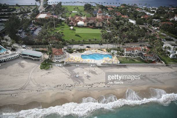 Waves from the Atlantic Ocean roll onto the beach adjacent to President Donald Trump's beach front MaraLago resort the day after Florida received an...