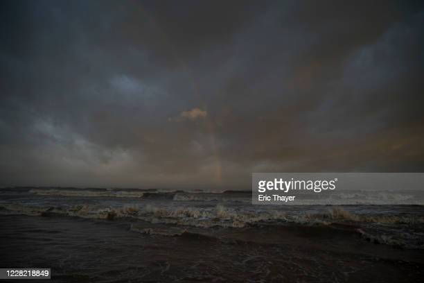 Waves from the storm surge from Hurricane Laura began to come ashore at Sea Rim State Park on August 26, 2020 in Sabine Pass, Texas. Laura rapidly...