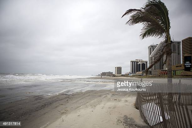 Waves hit the beach during high tide on October 4 2015 in Atlantic City New Jersey Some flooding and and power outages were reported all along the...