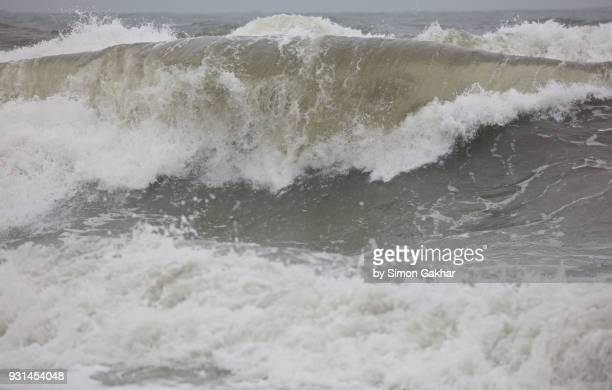 waves in a rough and stormy sea - falling water stock photos and pictures