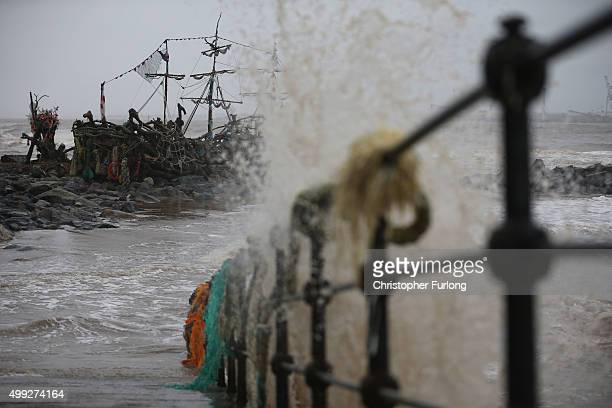 Waves lash the promenade of New Brighton next to the Black Pearl pirate ship art installation as the tail of Storm Clodagh moves across the country...