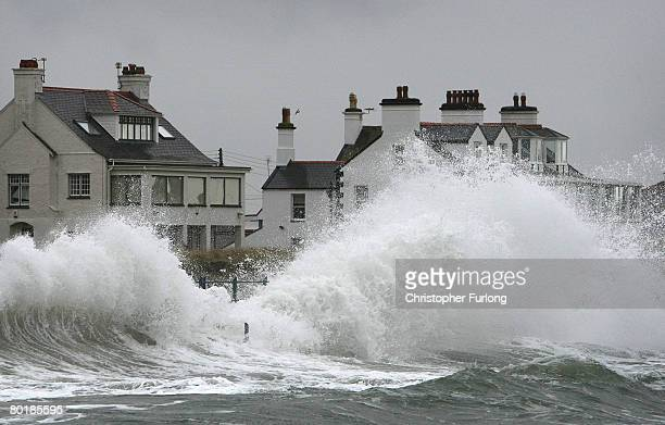 Waves lash the sea wall at Trearddur during high tide on March 10, 2008 in Holyhead, Wales. Weather forecasters are saying parts of the UK are being...
