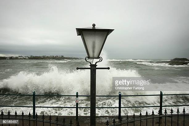 Waves lash the sea wall at Trearddur during high tide on March 10 near Holyhead, Wales. Weather forecasters are saying parts of the UK are being...