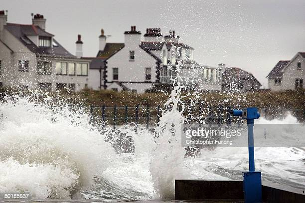 Waves lash the sea wall in Trearddur at high tide on March 10 near Holyhead Wales Weather forecasters are saying parts of the UK are being battered...