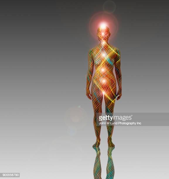 Waves of light in glowing futuristic woman