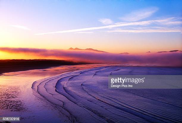 waves on beach at inch - inch stock pictures, royalty-free photos & images