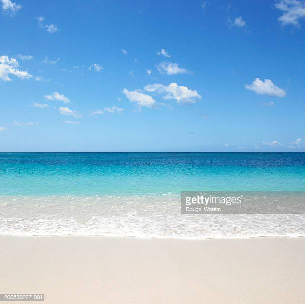 waves on beach - horizon over water stock pictures, royalty-free photos & images