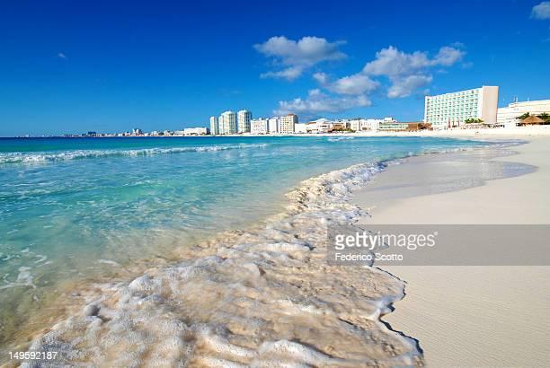 Waves on beach sand